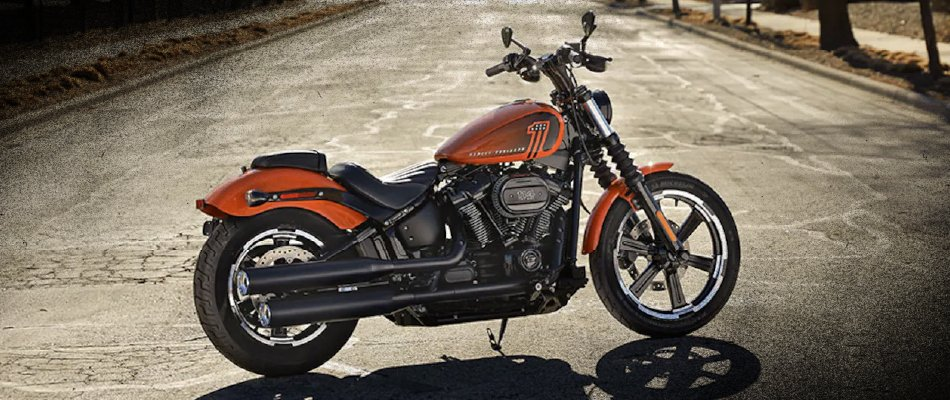 The 2021 Harley-Davidson Street Bob is available in colors like vivid black, deadwood green, and the pictured baja orange.